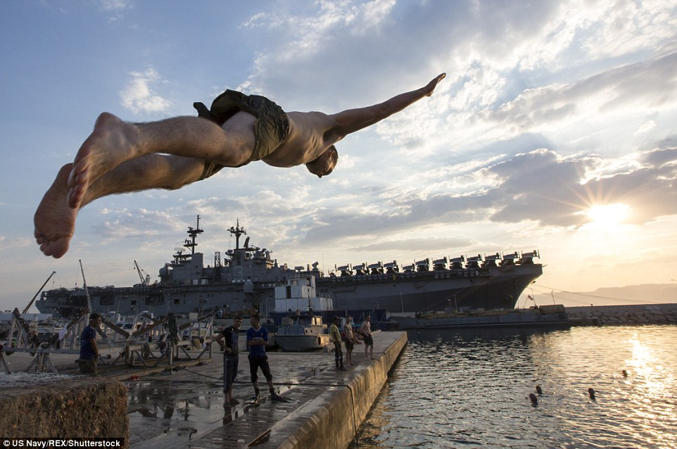 Swan dive:A Marine from the 26th Marine Expeditionary Unit (26th MEU) leaps into water in Jordan near the assault ship USS Kearsarge