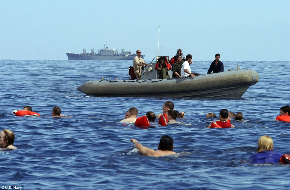 We're going to need a bigger boat: Not everyone is allowed to swim, with some having to watch the waters for any sharks lurking; This moment of RR came back in 2005 in the Indian Ocean on the hospital ship USNS Mercy and stores ship USNS San Jose