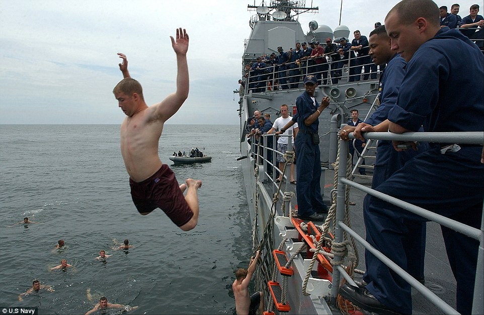 Hang time: Midshipmen 3rd Class Nicolas Field form Raleigh, NC, jumps off the fantail of USS Anzio during a swimcall back in 2004