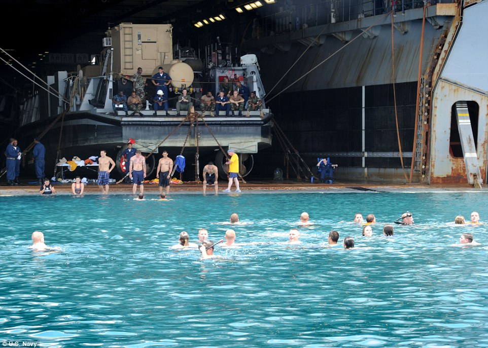 Beach resort: Service members on the USS Iwo Jima take a dip in the Caribbean waters during a swim call off the coast of Bluefields, Nicaragua, back in 2010