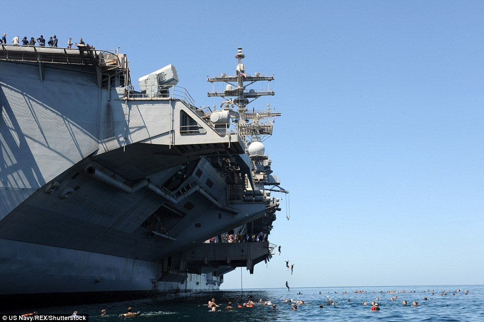 Long way down: The activity is usually enjoyed in warm foreign waters, such as the Mediterranean, Arabian and South China seas and the Indian and Pacific oceans; In this case, sailors from the USS Dwight D Eisenhower jump into the Arabian Sea