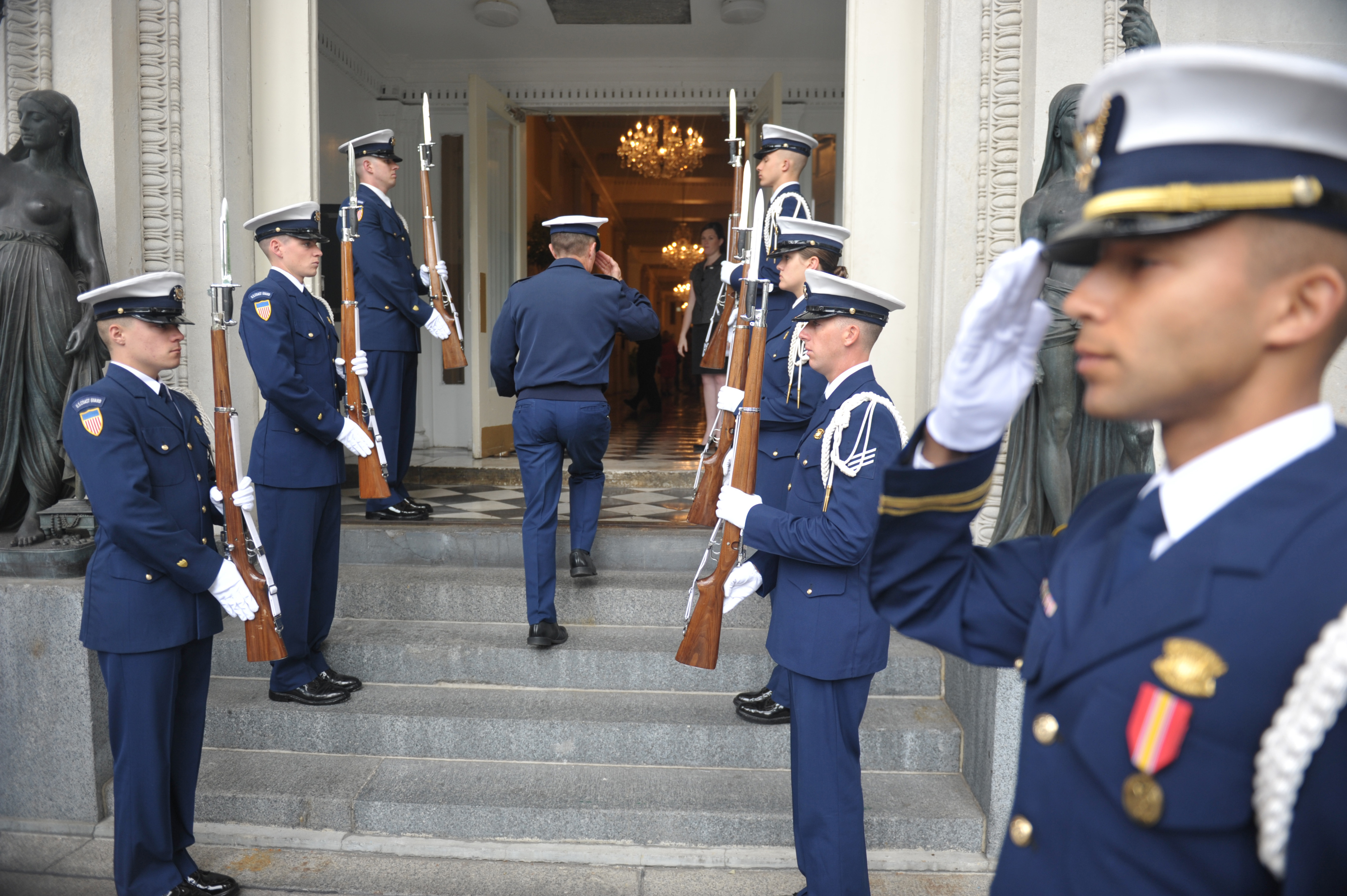 NEW ORLEANS - Capt. Eric Jones, the commanding officer of the Coast Guard Cutter Eagle, walks into Gallier Hall in New Orleans for the mayoral welcome, April 18, 2012. The mayoral welcome is to welcome the commanding officers of the cutters that pulled into the port of New Orleans and to kick off the NOLA Navy Week's events. U.S. Coast Guard photo by Petty Officer 1st Class Brandyn Hill.