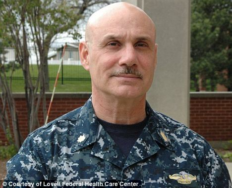 Hero: Knowing the danger, U.S. Navy Nurse Corps Lieutenant Commander James Gennari, pictured, heroically helped the wounded Corporal Perez, saving his fellow soldier's life while risking his own