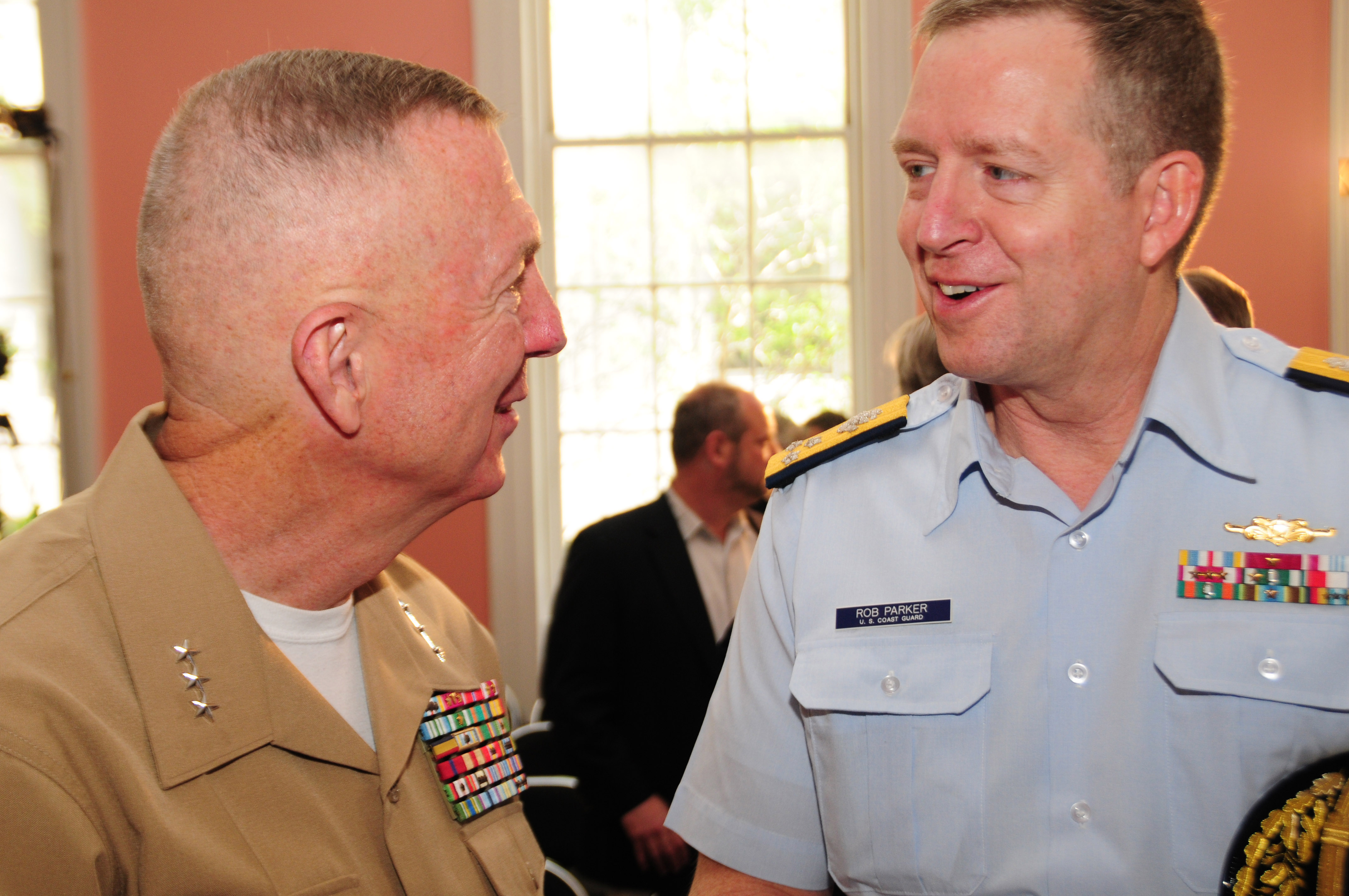 NEW ORLEANS - Vice Adm. Robert Parker (right), commander of Coast Guard Atlantic Area, chats with Lt. Gen. Steven Hummer, commander of Marine Forces Reserve and Marine Forces North, at the conclusion of a mayoral welcome for participants and guests of NOLA Navy Week at Gallier Hall, April 18, 2012. Parker, the commander of the Eighth Coast Guard District and the commanding officer of the Coast Guard Barque Eagle attended the event for the Bicentennial of the War of 1812. U.S. Coast Guard photo by Petty Officer 2nd Class Bill Colclough.