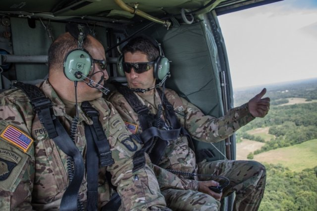 House Speaker Paul Ryan (R-Wisconsin) and Division Commander Maj. Gen. Andrew Poppas fly in a UH-60 Black Hawk helicopter above Fort Campbell, Kentucky, during a visit, July 10. The purpose of the visit was to allow the Speaker to see the division's capabilities and what it is like to be a Soldier for a day.