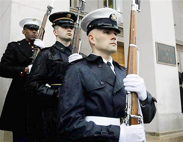 A United States military honor guard stands by their post in front of the Pentagon in Washington