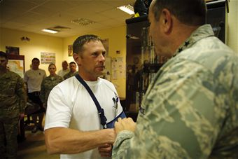 Breedlove presents Purple Heart to wounded Airman